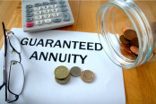 Guaranteed Annuity with coins on paper