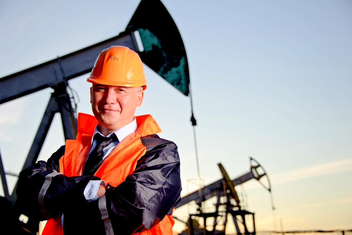 Oil worker in orange uniform