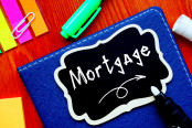 Financial concept meaning Mortgage with sign on the page