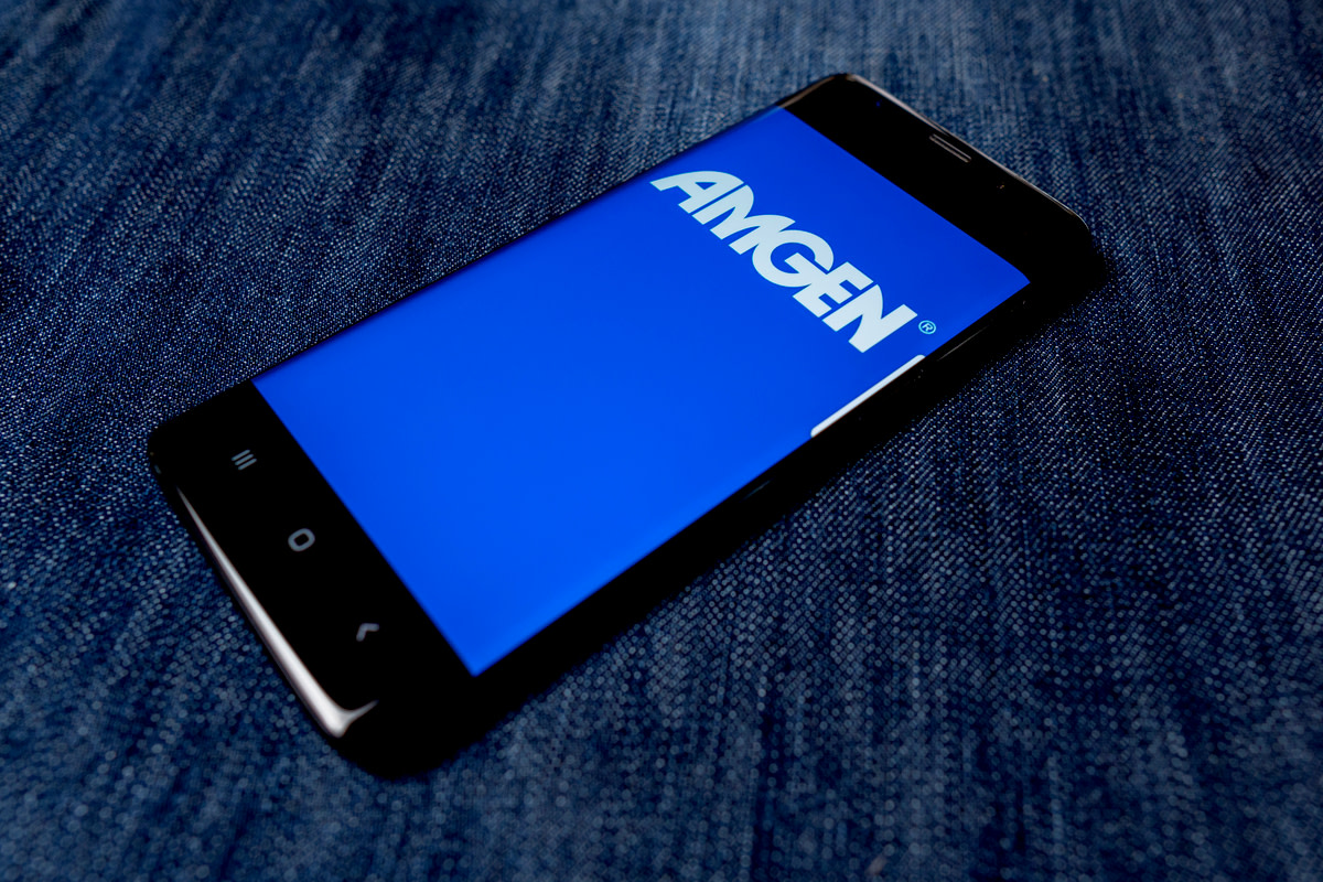 Amgen Inc logo visible on smartphone screen