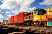 Container Freight Train with cloudy sky