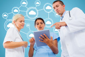 doctors discussing over digital tablet with cloud computing icons