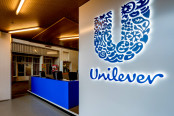 The blue Unilever sign next to the desk
