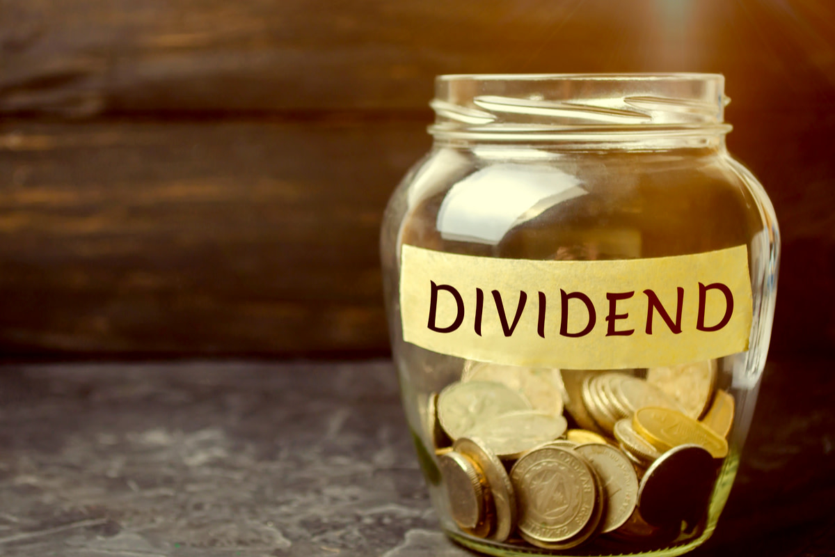 Glass jar with the word Dividend