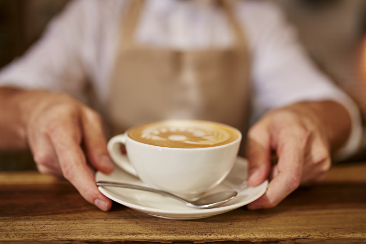 Close up of man serving coffee