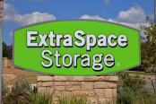 Signs advertising an Extra Space Storage facility