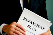 Repayment Plan that the man holds