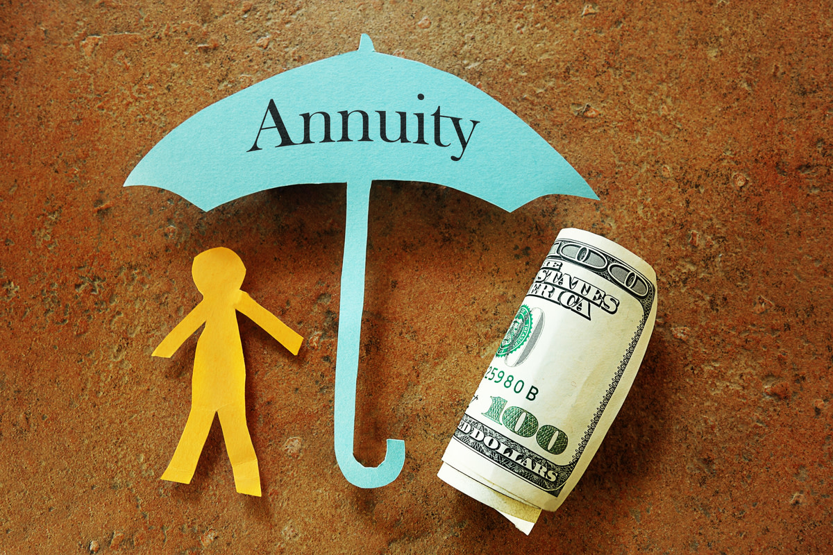 Annuity umbrella over a paper cutout person