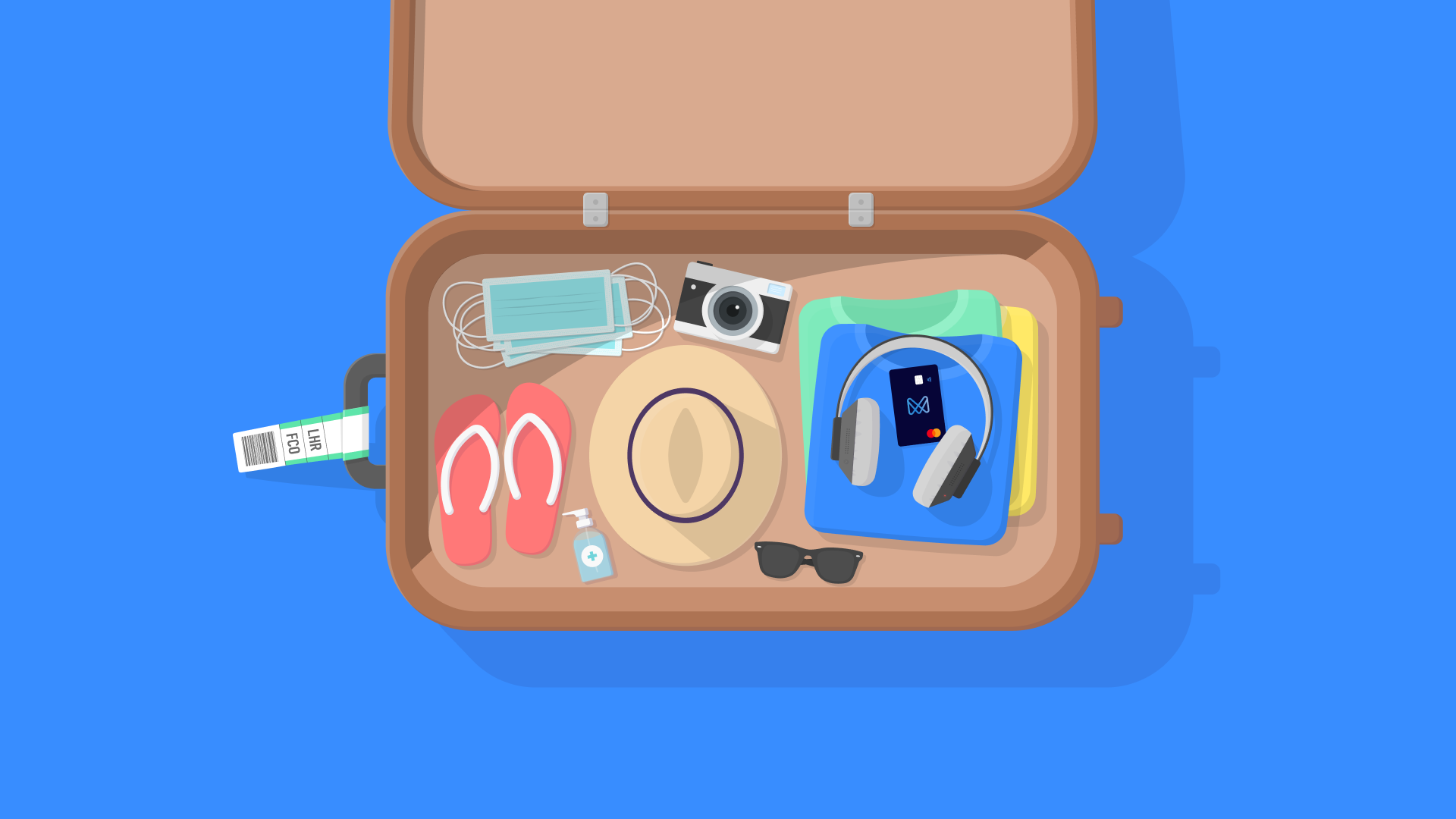 Brown suitcase filled with reddish flip flips, masks, Monese card, headphones, clothes, hand sanitiser, hat, camera, sunglasses