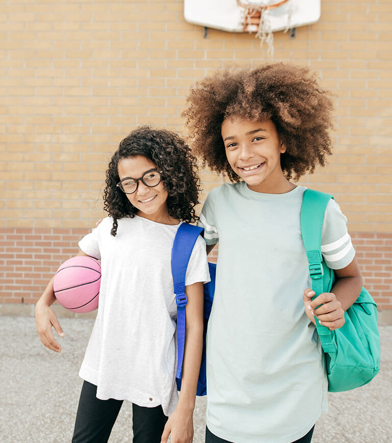 two girls near basketball hoop
