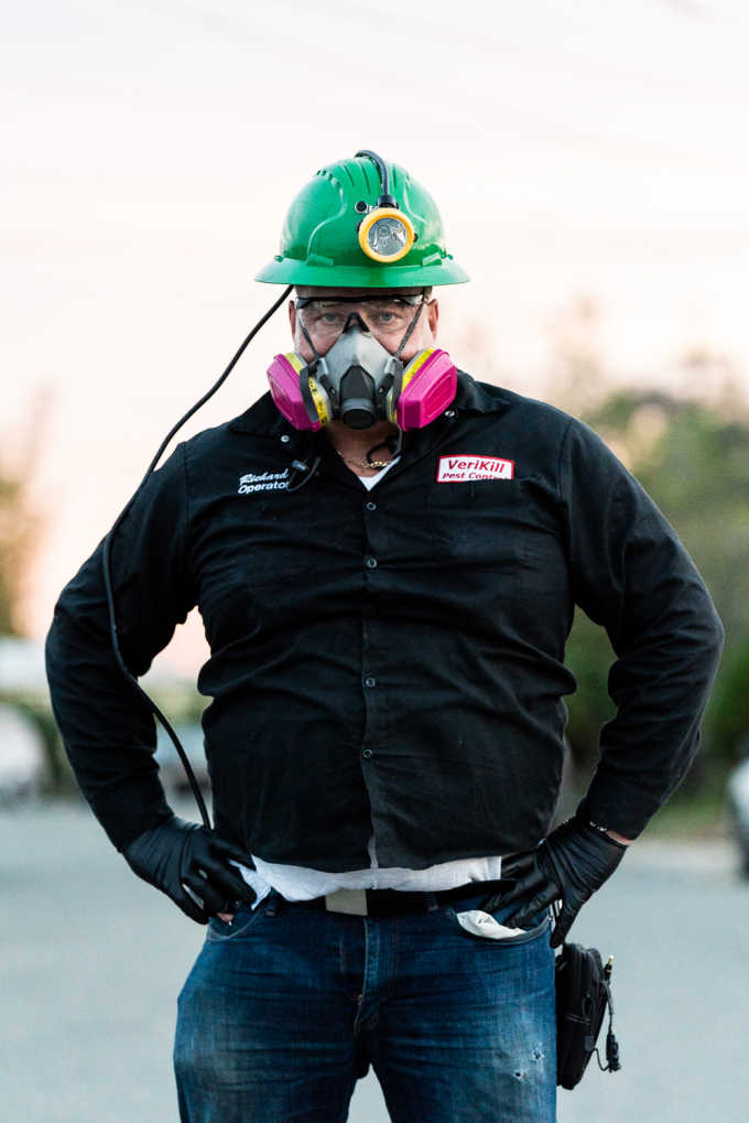 Richard of Verkill Pest Control wearing a pink mask and green helmet