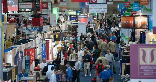 Electricians at an electrical trade show