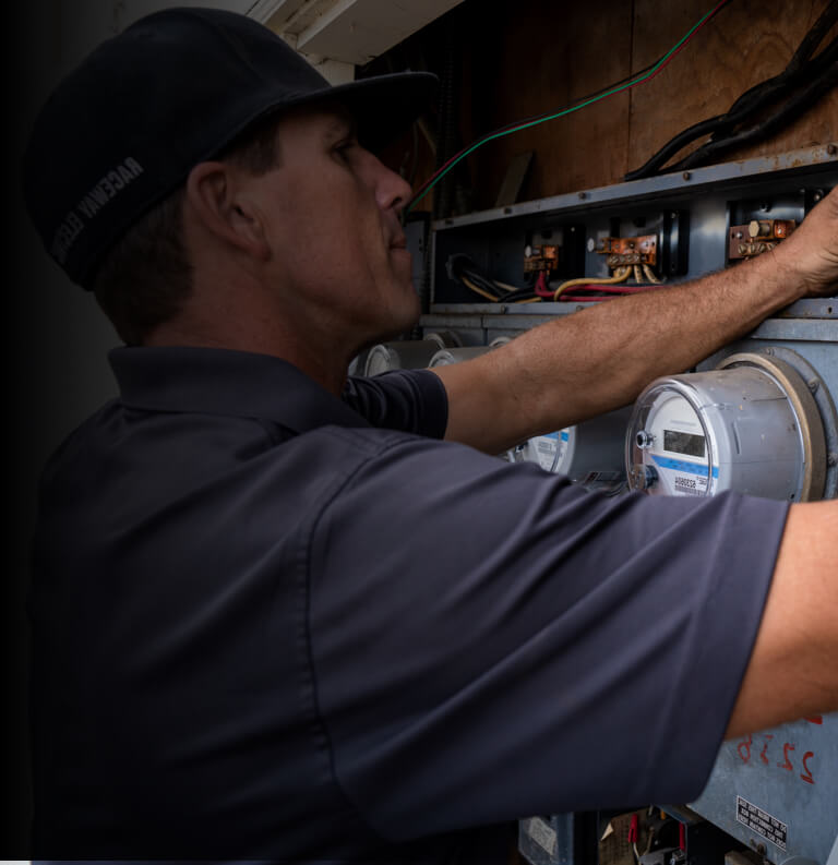 Electrician working on an electrical unit