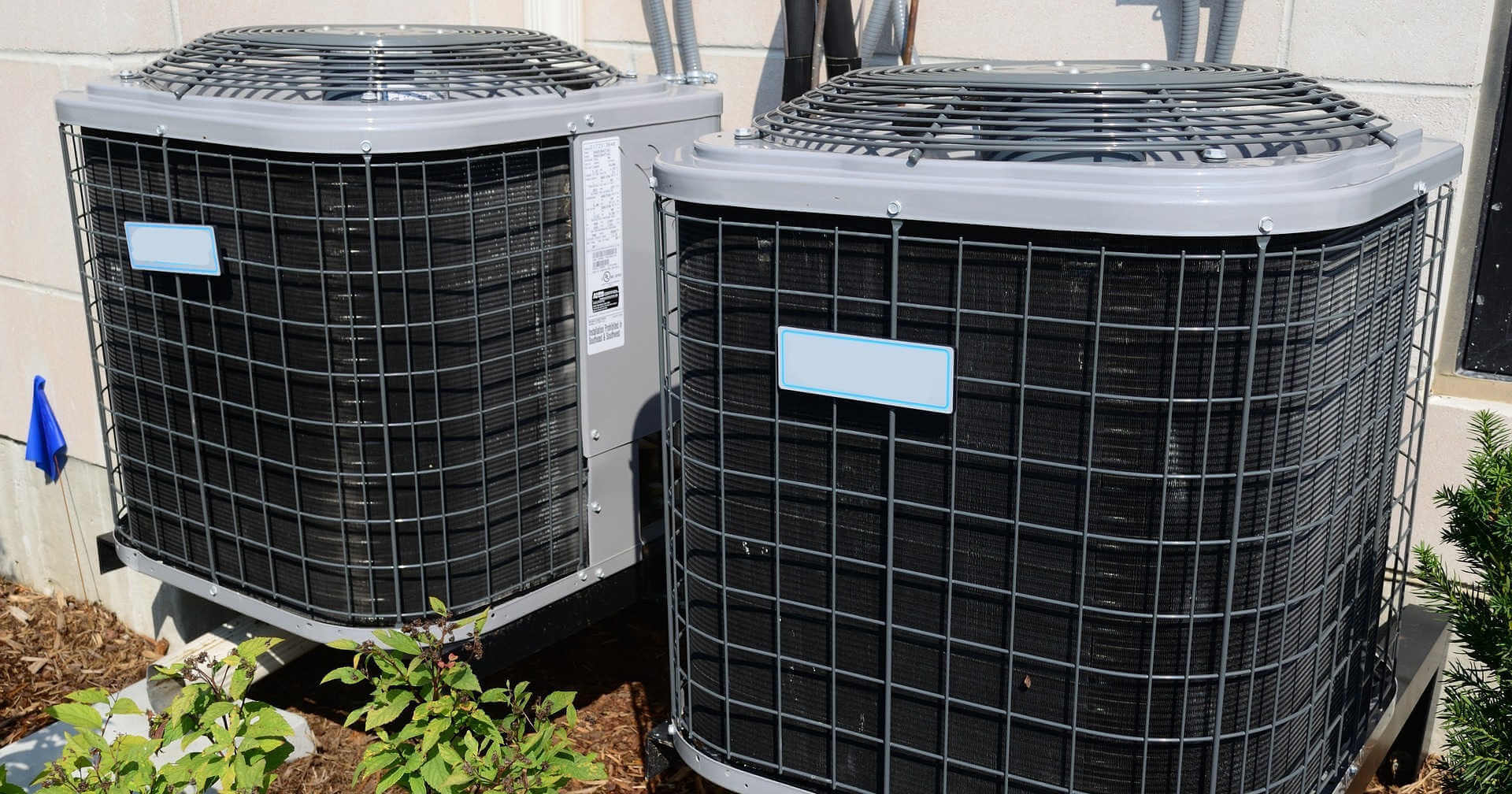 Two unmarked HVAC units installed by an HVAC business