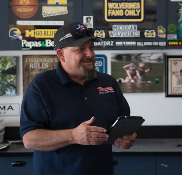 Redding Comfort Heating & Air Pro holding a tablet