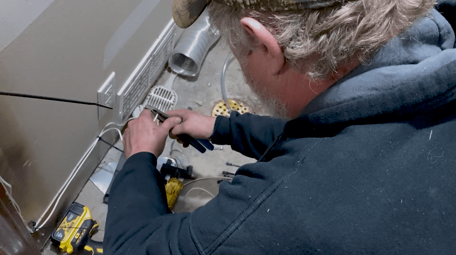 HVAC Technician Using Tools
