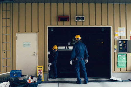 HVAC Technicians Standing In Doorway