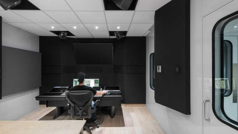 Man sitting at the audio console of Studio A Dolby Atmos.  - Homepage / game audio