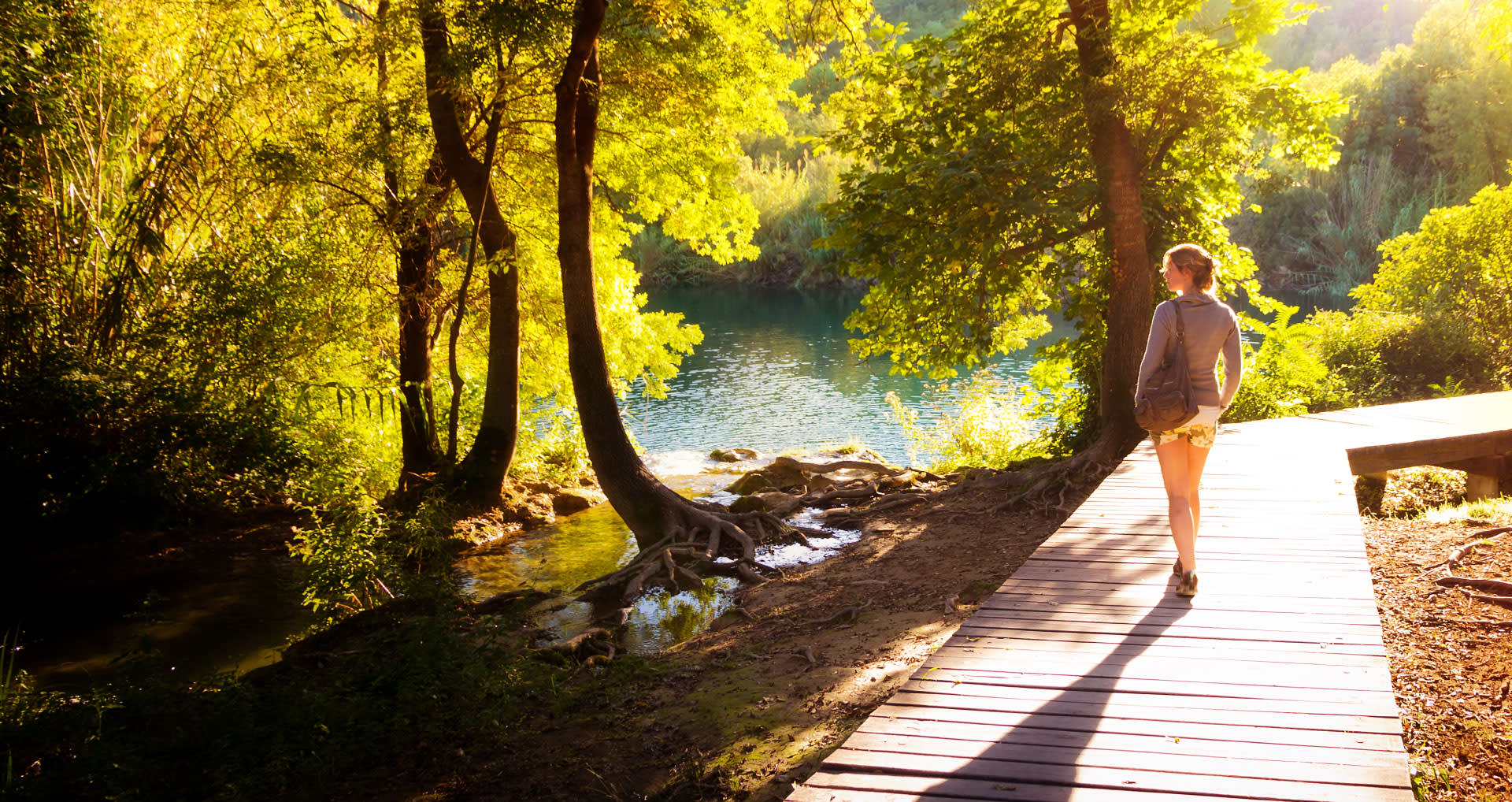 woman-walking-on-a-shaded-walkway-healthily