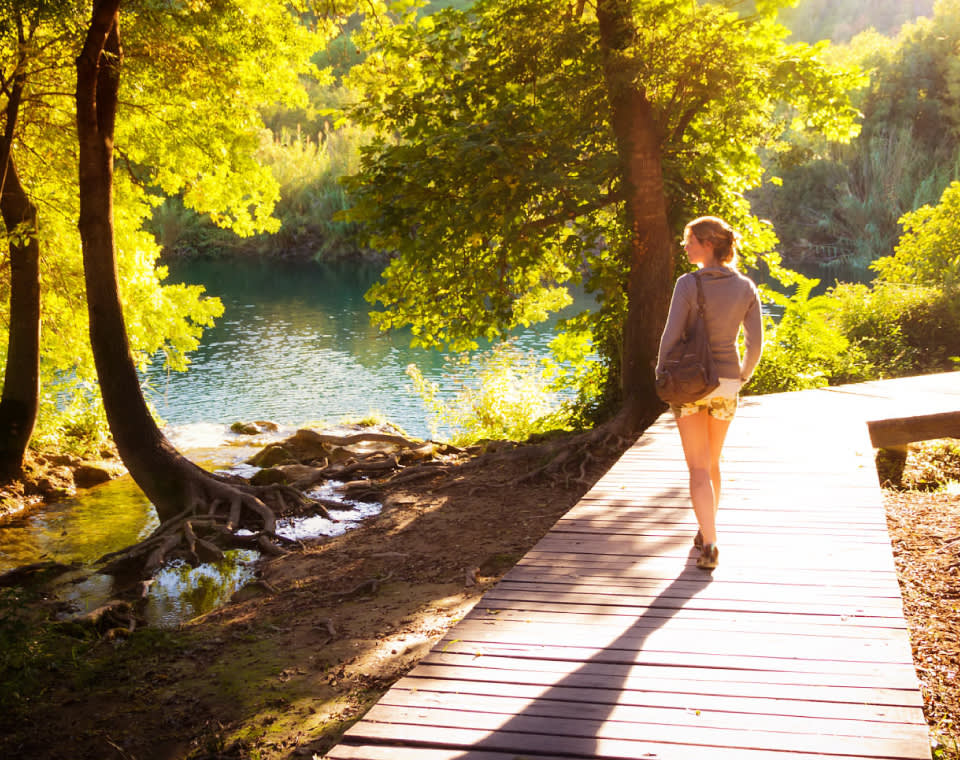 woman-walking-in-forest-small-healthily