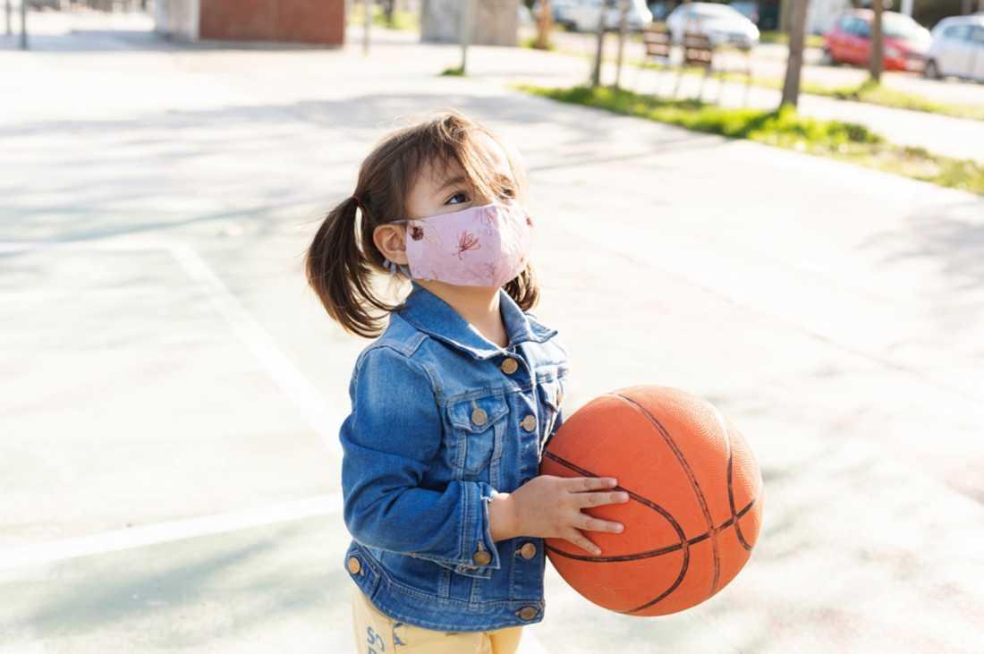girl-in-mask-holding-basketball