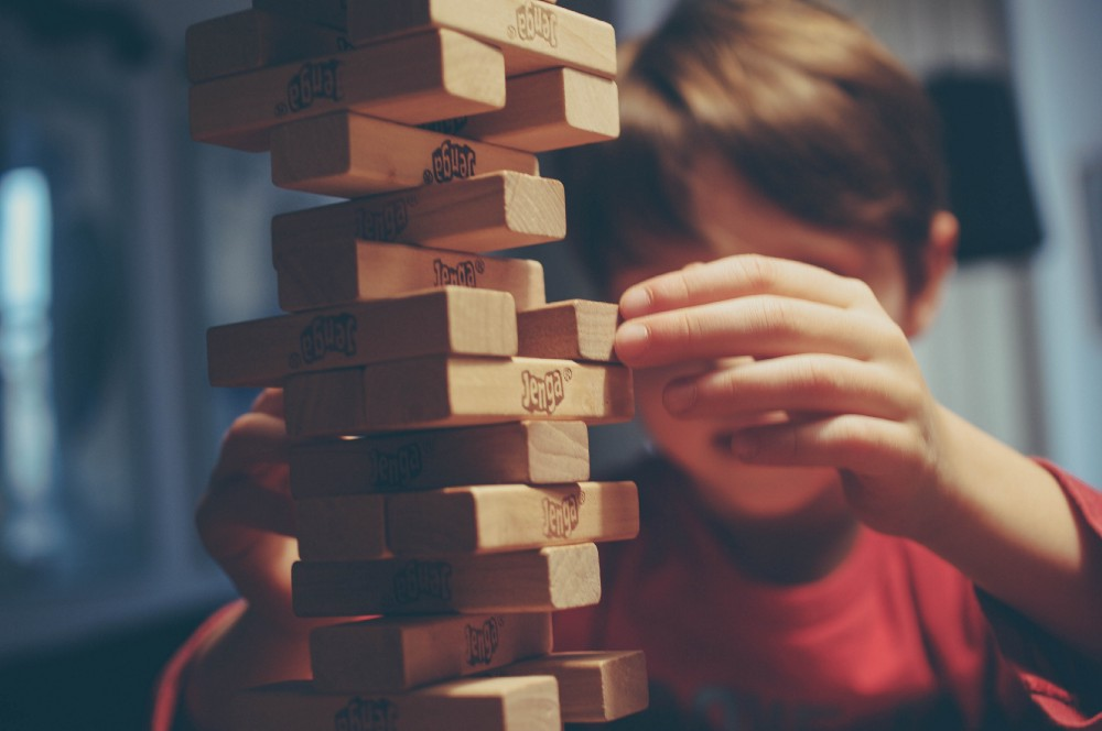 A boy playing Jenga