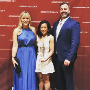 Lexie Stoker, Client Services Director Rachael Dao and CEO Peter Harris accept the award for LT Network.