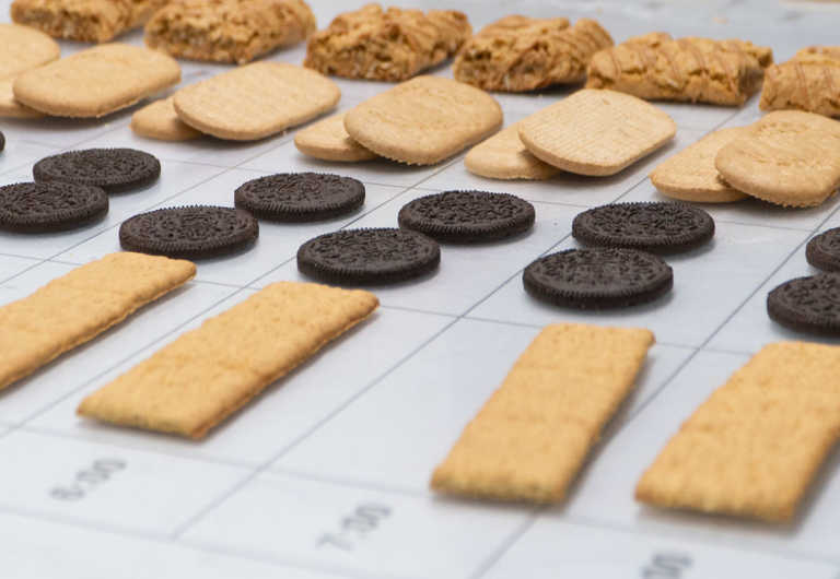 Various cookies and biscuits sit on a measuring table