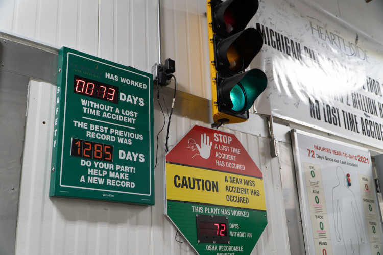 Two time-counter signs displaying that a facility has gone up to 1285 days without a lost-time accident