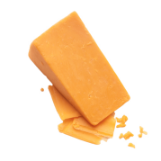 A large block of cheese sitting atop a few small slices.