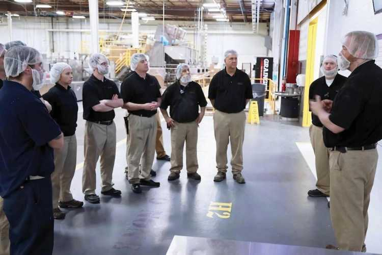 Hearthside team members undergo safety training in a standing semi-circle