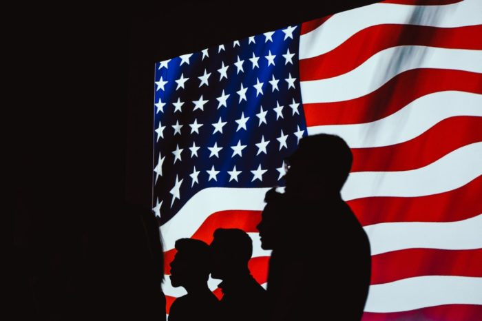 silhouette-of-people-beside-usa-flag-1046399-700x466