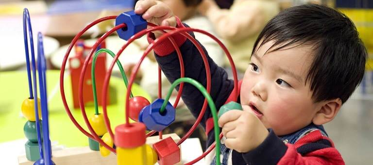 Baby playing with an abacus