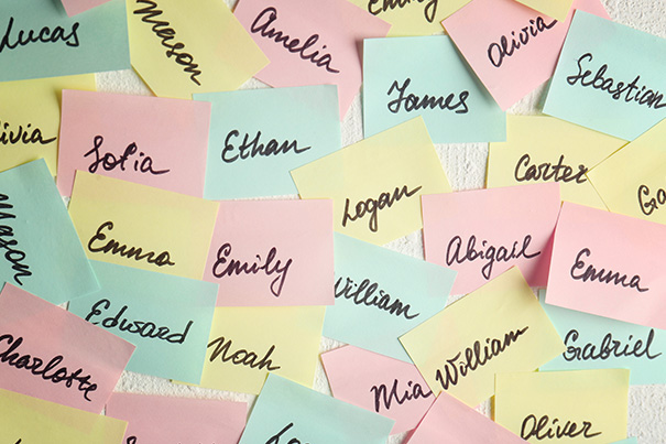 Multicolored post-it-notes with baby name suggestions on them