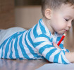 Toddler and baby drawing together
