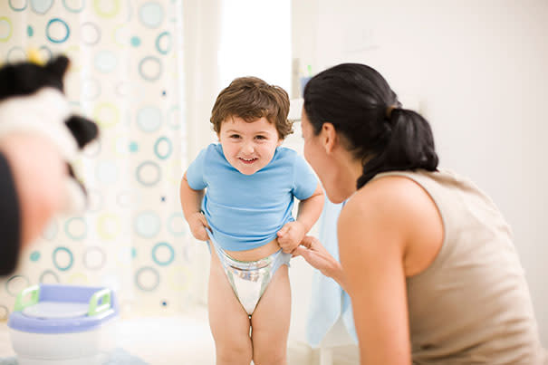 Toddler putting on training pants