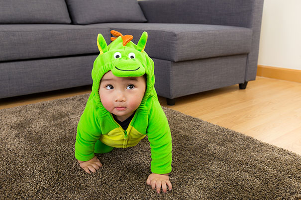 Baby in adorable dinosaur halloween costume