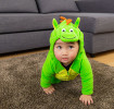 Baby in adorable dinosaur halloween costume
