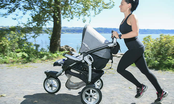 Mom running with baby