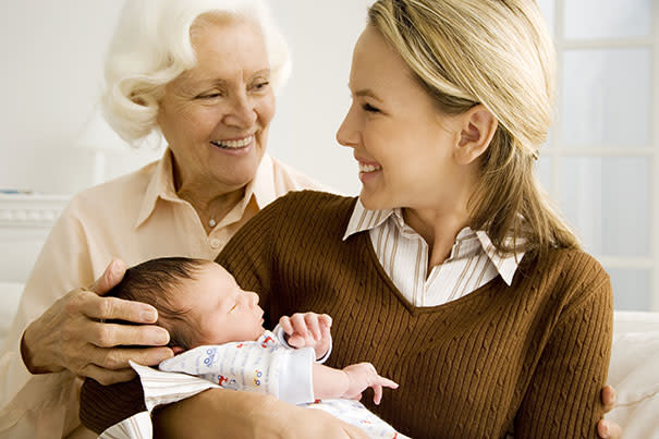 Mom and grandmother watching baby