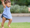 Baby playing in the park with parents