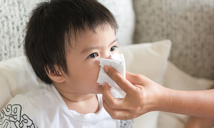 Mom taking care of sick toddler
