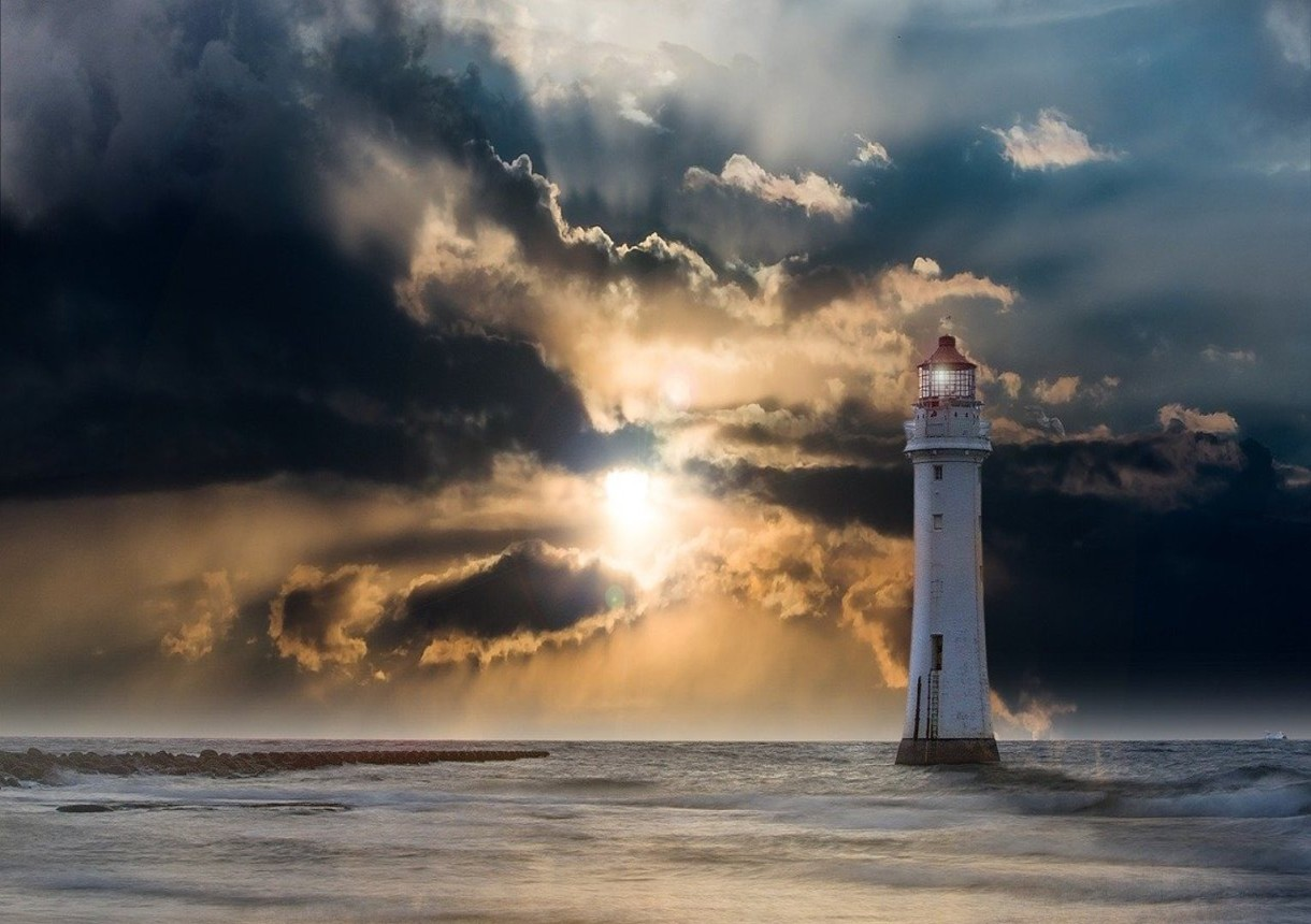 Lighthouse and sun rays