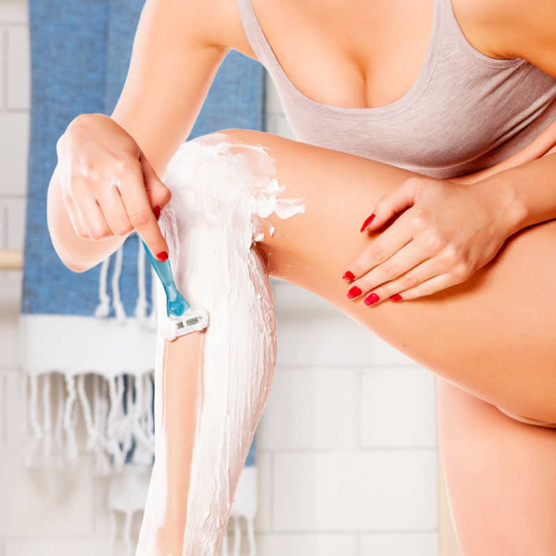 Woman Using a Shave Gel to Shave the Legs