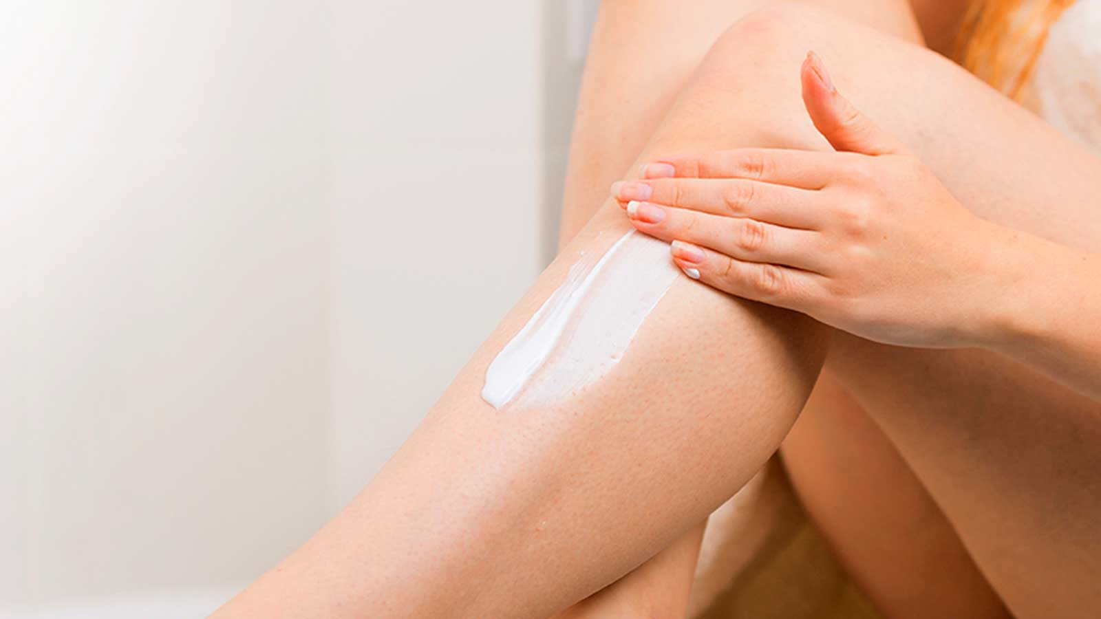 Woman Moisturize Her Legs After Shaving