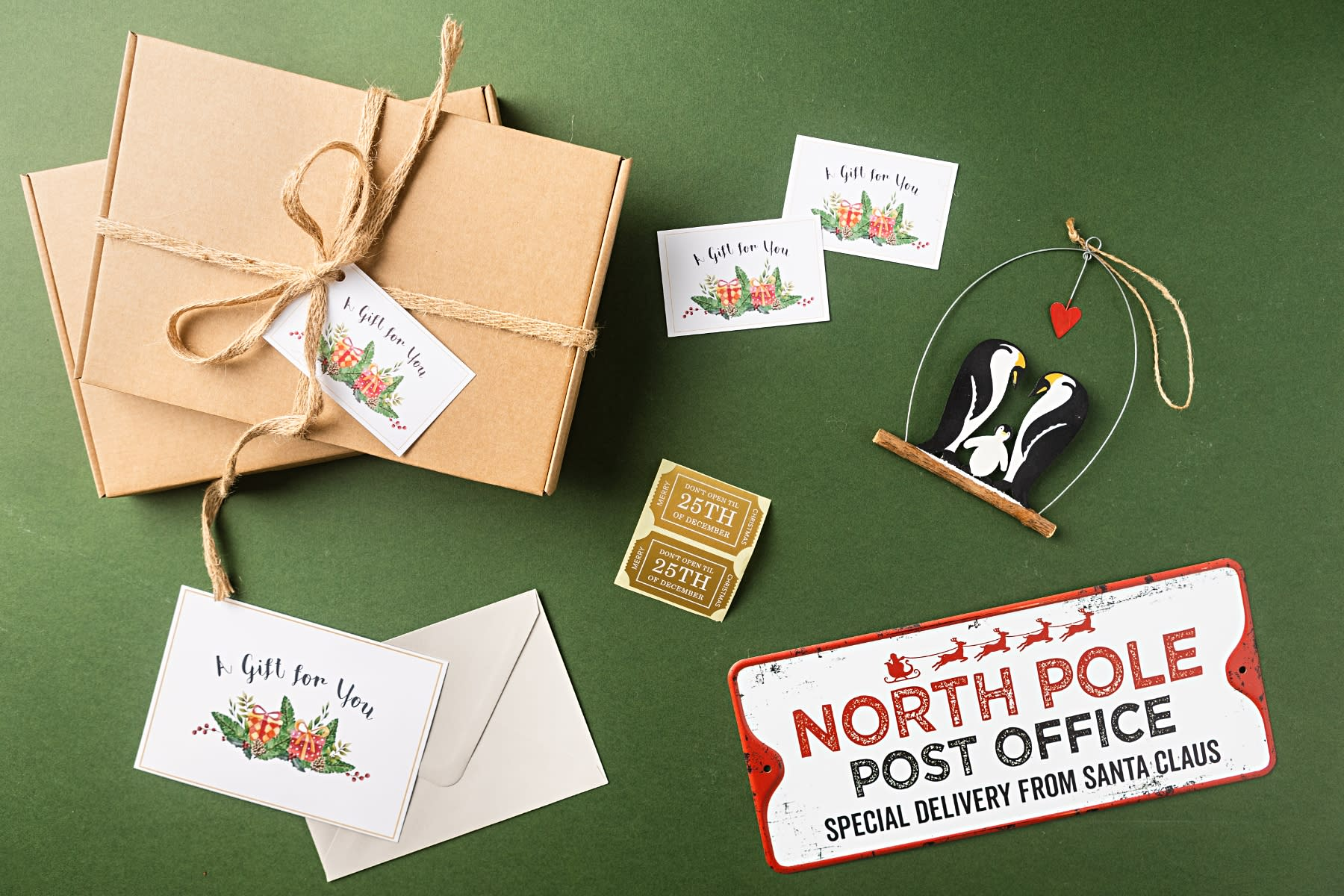 A flat lay image of our letterbox gift accessories including our mail boxes, stickers and 'A gift for you' card.