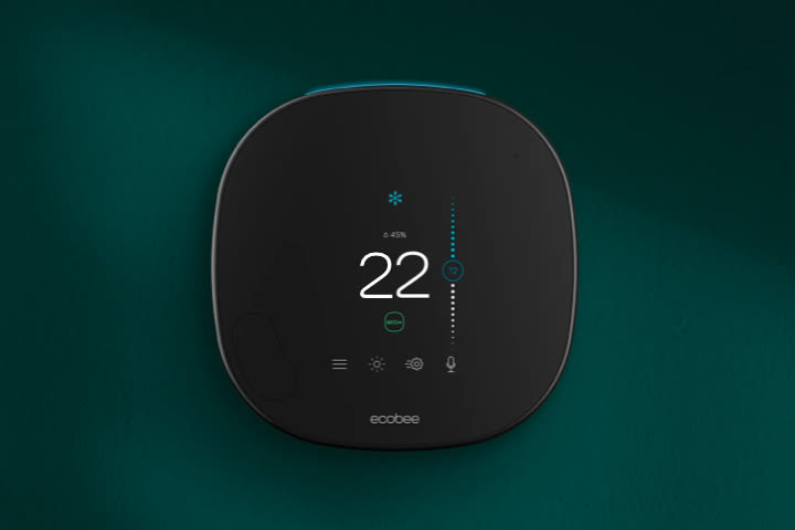 An ecobee thermostat on a green background.