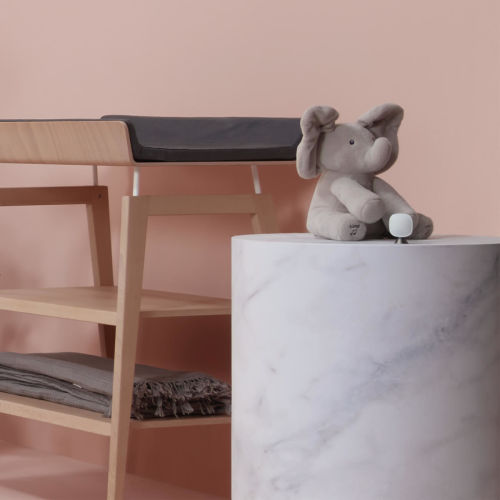 SmartSensor by a stuffed animal on a marble pedestal