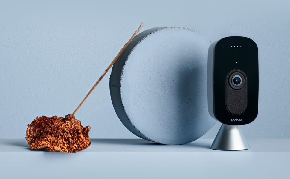 The ecobee SmartCamera on a blue background.