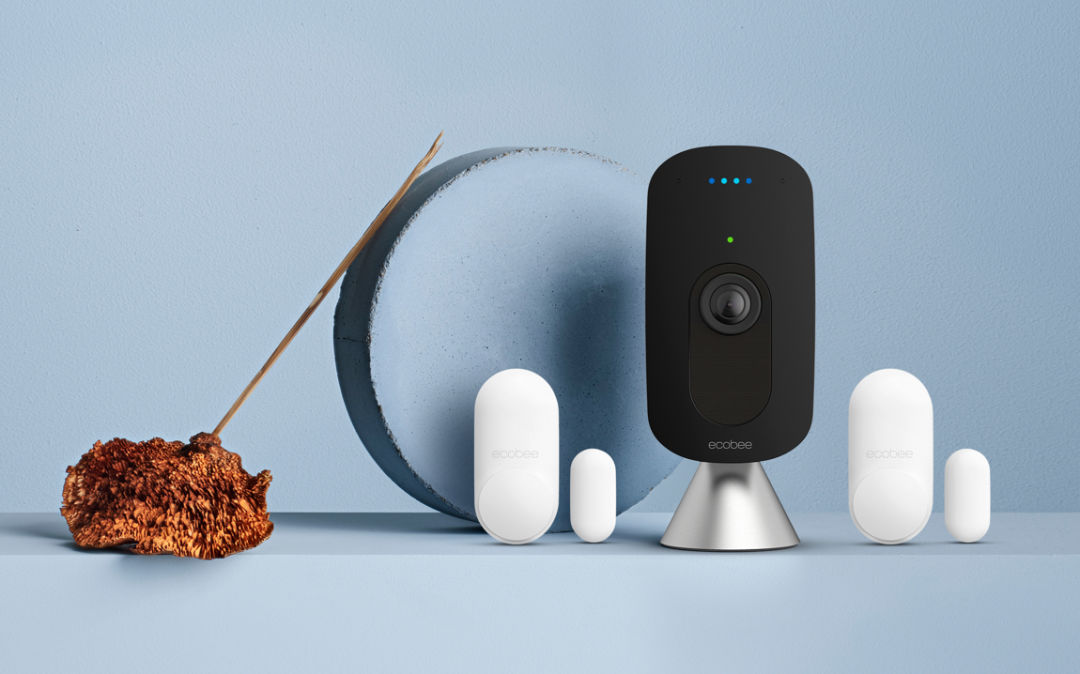 ecobee SmartCamera and 2 ecobee SmartSensors for doors & windows on a blue background.